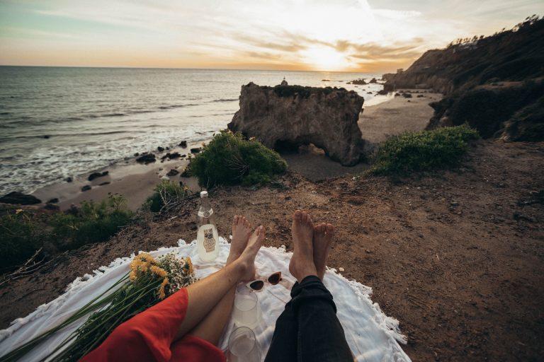 sitting on a blanket overlooking el matador beach